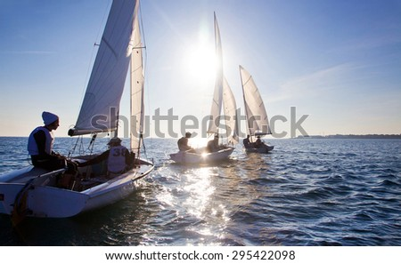 Beautiful view of sailing yachts at sunset - stock photo