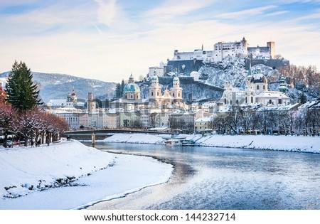 Beautiful view of Salzburg skyline with Festung Hohensalzburg and river Salzach in winter, Salzburger Land, Austria - stock photo