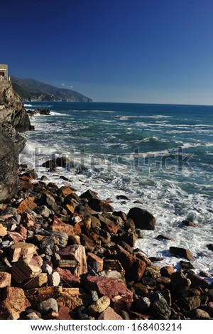 Beautiful view of Seascape in Monterosso al Mare Beach - a village in the National park of Cinque Terre, Italy. Colorful harbor at Monterosso. scenic Italy series. - stock photo