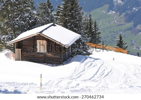 beautiful view of small alps cottage in winter - stock photo