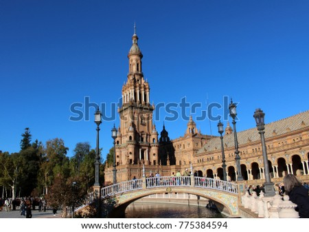 Beautiful view of the bell tower and the bridge in the square (Plaza de Espana)/ Seville, Spain
