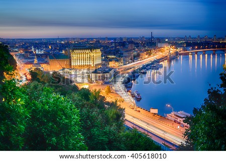 Beautiful View of the Dnieper river, River station, Havana bridge and Naberezhno-Kreschatitska street in Kiev, Ukraine. Night panorama of Kyiv - stock photo