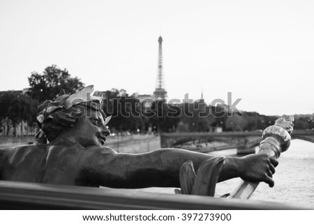 Beautiful view of the Eiffel Tower from the Concorde Bridge. View on Seine river, sculpture on Alexander III bridge in Paris, France. Black and white vintage photo. Retro travel picture. - stock photo