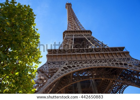Beautiful view of the Eiffel Tower in Paris. View of the sky and trees.