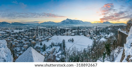 Beautiful view of the historic city of Salzburg and mountains from top of Festung Hohensalzburg in winter at sunset, Salzburger Land, Austria