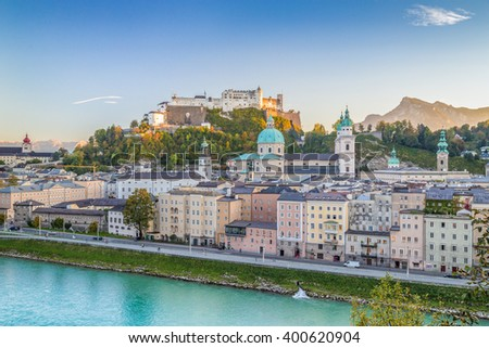 Beautiful view of the historic city of Salzburg with Hohensalzburg Fortress in beautiful golden evening light at sunset, Salzburger Land, Austria - stock photo