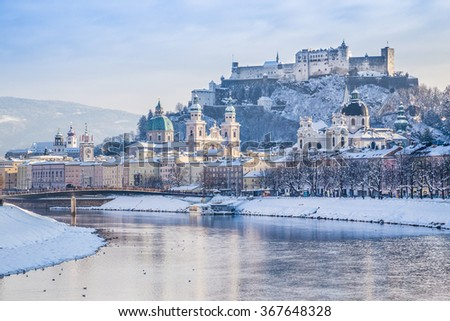 Beautiful view of the historic city of Salzburg with Salzach river in winter during blue hour, Salzburger Land, Austria - stock photo