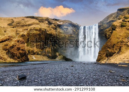 Beautiful view of the magnificent Skogafoss waterfall in Iceland - stock photo