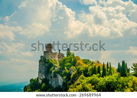 Beautiful view of the medieval fortress De La Fratta or Cesta overlooking the green hills of San Marino republic. - stock photo
