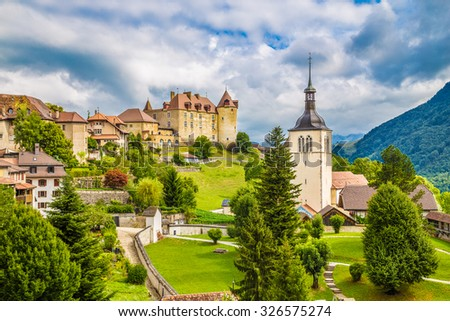 Beautiful view of the medieval town of Gruyeres, home to the world-famous Le Gruyere cheese, canton of Fribourg, Switzerland - stock photo