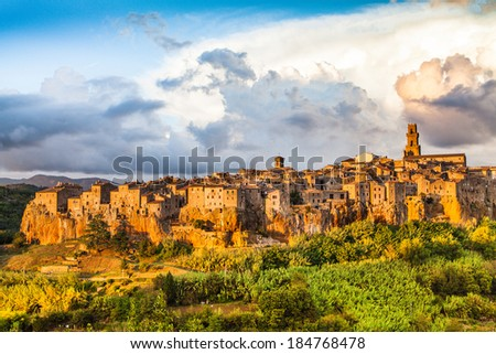 Beautiful view of the medieval town of Pitigliano with dramatic cloudscape at sunset, Tuscany, Italy - stock photo