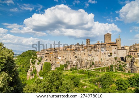 Beautiful view of the medieval town of Vitorchiano with stunning cloudscape, province of Viterbo, Lazio, Italy - stock photo