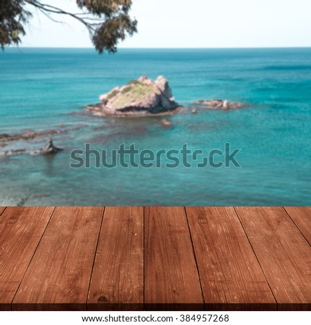 Beautiful view of the Mediterranean Sea over old dark wooden table or board. Collage. Selective Focus. Toned. - stock photo