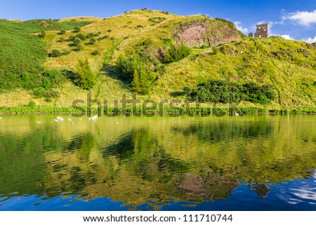 Beautiful view of the mountains reflected in a lake - stock photo
