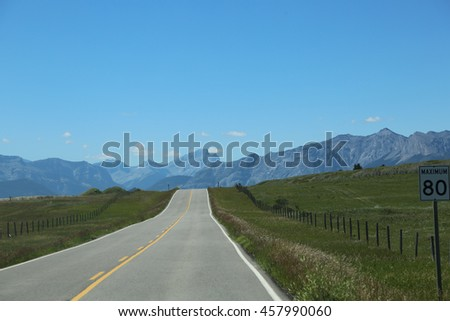 Beautiful View of the road and Rocky Mountains in Alberta, Canada