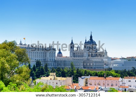 Beautiful view of the Royal Palace of Madrid and the Cathedral of Saint Mary the Royal of La Almudena on the blue sky background in Spain at summer. Madrid is a popular tourist destination of Europe. - stock photo