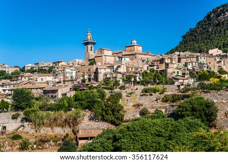 Beautiful view of the small town Valldemossa situated in  picturesque mountains on Mallorca island, Spain.
