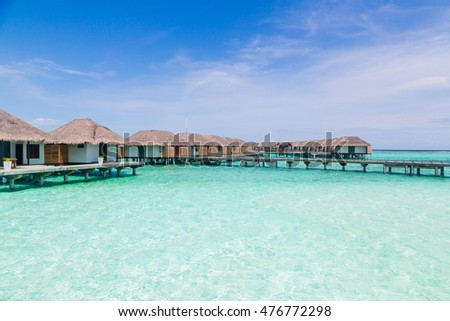 Beautiful view of the water villas on Maldives with jetty among them.