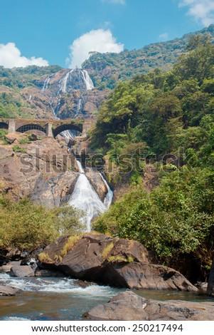 Beautiful view of the waterfall Dudhsagar and railroad bridge in Goa/India - stock photo