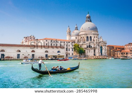 Beautiful view of traditional Gondola on Canal Grande with historic Basilica di Santa Maria della Salute in the background on a sunny day in Venice, Italy - stock photo