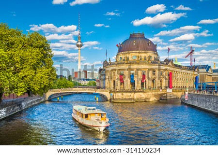 Beautiful view of UNESCO World Heritage Site Museumsinsel (Museum Island) with excursion boat on Spree river, Berlin, Germany - stock photo