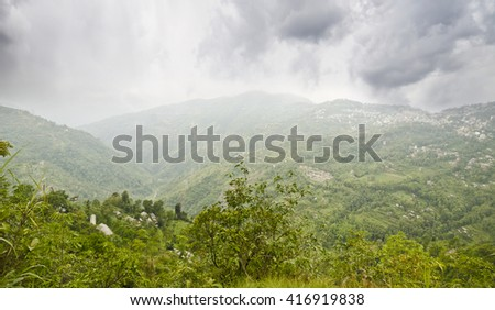 Beautiful View of Valley at Sikkim near Pelling with Stormy Clouds. - stock photo