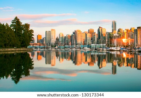 Beautiful view of Vancouver skyline with Stanley Park at sunset, British Columbia, Canada - stock photo