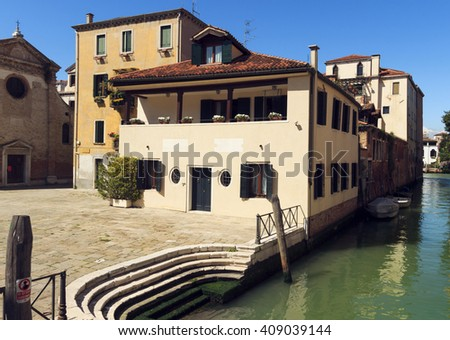 beautiful view of Venice Canal and ancient pier. sunny day landscape with historical houses, traditional church and square. Italy romantic destination scenic. famous European Union place - stock photo
