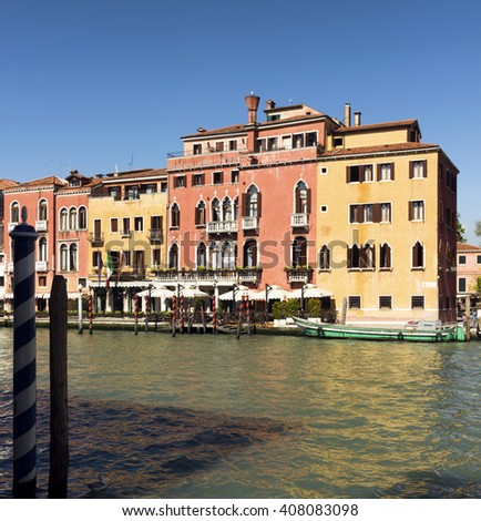 beautiful view of Venice Canal. sunny day landscape with historical houses, traditional boats and colorful buildings. Italy travel destination scenic. famous European Union places - stock photo
