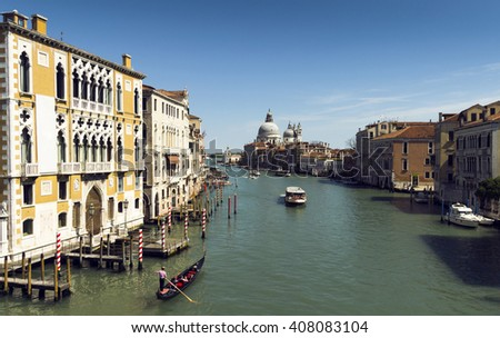 beautiful view of Venice Grand Canal. sunny day landscape with historical houses, traditional Gondola boats and colorful buildings. Italy travel destination scenic. famous European Union places - stock photo