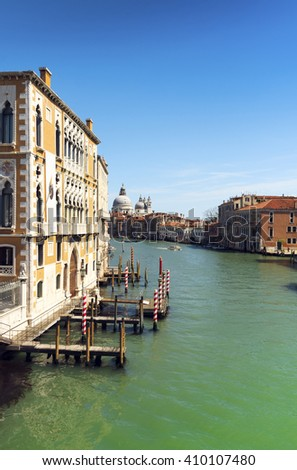 beautiful view of Venice Grand Canal. sunny day landscape with historical houses, traditional Gondola boats, colorful buildings. romantic Italy travel destination scenic. famous European Union places - stock photo