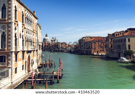 beautiful view of Venice Grand Canal. sunny day landscape with historical houses, traditional Gondola boats, colorful buildings. romantic Italy voyage destination scenic. famous European Union places - stock photo
