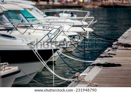 Beautiful view of white yachts moored at wharf - stock photo