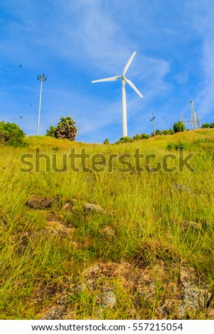 Beautiful view of wind turbine in a wind farm against a clear blue sky producing alternative energy