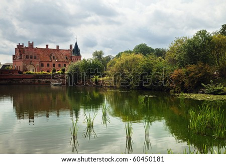 Beautiful view on medieval castle across the pond