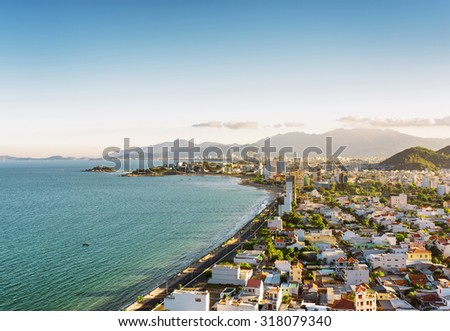 Beautiful view on Nha Trang and Nha Trang Bay of the South China Sea on blue sky background in Khanh Hoa province at afternoon in Vietnam. Nha Trang is a popular tourist destination of Asia. - stock photo