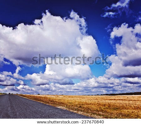 Beautiful  view on road and field with beauty cloudy sky instagram stile - stock photo