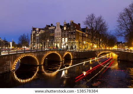 Beautiful view on the canals of Amsterdam, an Unesco world heritage site, in the Netherlands at twilight - stock photo