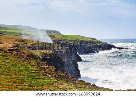 Beautiful view on the cliffs of Moher at the coast of Ireland  - stock photo