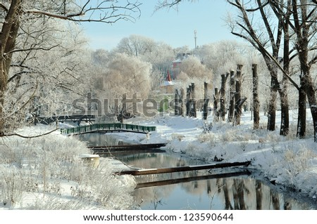 Beautiful view on the river and park in winter - stock photo