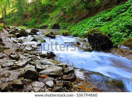 Beautiful view on the river coming from Shypit waterfall in Ukraine - stock photo