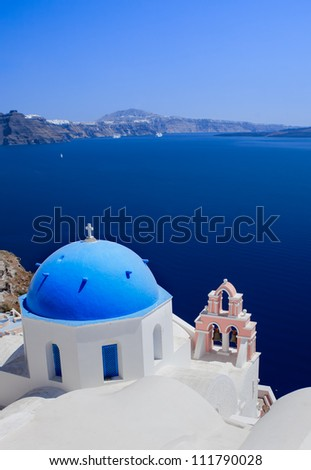 Beautiful view over a church on Santorini - stock photo