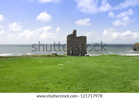 Beautiful view over the Ballybunion beach castle and cliffs in Ireland - stock photo