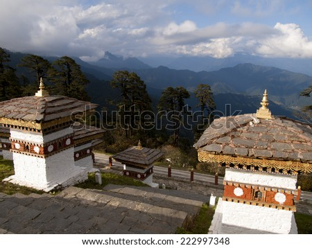 Beautiful view over the himalayan mountains from the 108 chortens on the Dochula Pass between Punakha and Thimpu in Bhutan - stock photo