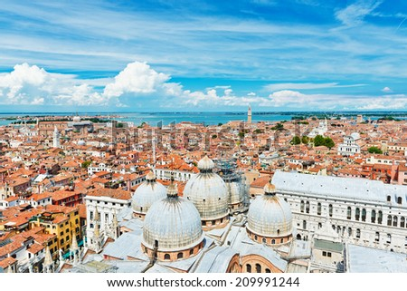 Beautiful views of the Mediterranean traditional houses Venice with red tile roofs from Campanile di San Marco. Venice, Italy, Europe  - stock photo