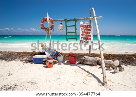 Beautiful views of the ocean on a background of clear turquoise water, blue sea and boats. In the foreground is a colorful water station for tourists