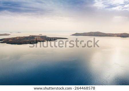 Beautiful views of the sea and islands. Santorini island, Greece. - stock photo
