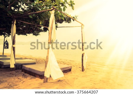 Beautiful vintage beach and sea with deck , chair and umbrella - Vintage Filter and Sunflare effect