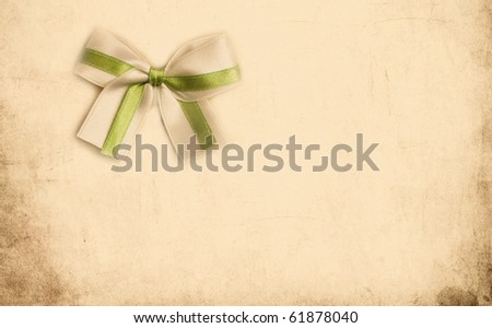 Beautiful vintage card for congratulations or invitation with a wonderful bow - stock photo