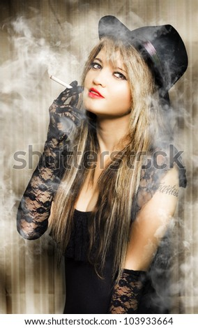 beautiful vintage girl smoking cigarette with pretty smile in a creative pinup style portrait - stock photo
